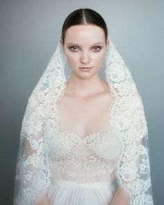 "With its classic scalloped edging and chaste shoulder coverage, a mantilla veil, which originated in Spain, gives any wedding look a decidedly Old World feel. They're often pinned at the hairline with a comb to frame the face, but we placed ours below the crown to strike an airier note while still providing a modest screen for a revealing bodice cut entirely from Chantilly lace. The Details: Delphine Manivet veil, price upon request, 847-800-6312. Reem Acra ""She's My Dream"" dress, $4,99..."