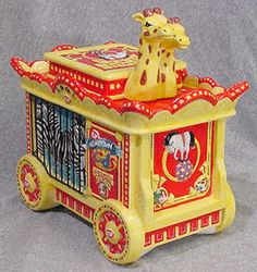 early glass cookie jar with circus theme. - reminds me of animal crackers that came in the little box!