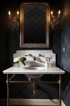 powder room - black walls, antique sconces and mirror.