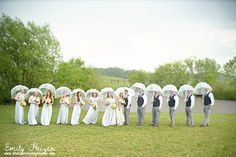Don't let the sunshine spoil your rain! Rainy day wedding portraits by Emily Heizer.
