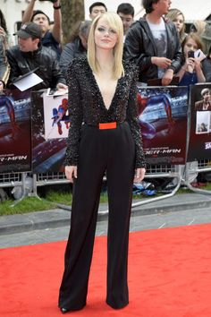 Emma Stone in a black embellished Elie Saab jumpsuit. Loving the colour pop from the belt!