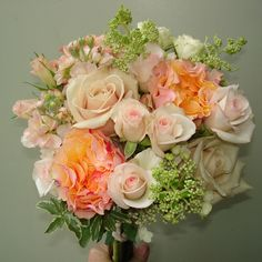 Peach and cream bridesmaids bouquet with roses, hydrangea, and stock.  Flowers and photo by Karyn Schneider at The Petal Patch, McFarland, WI.