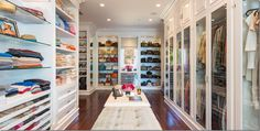 glassed in doors in master closet on the right, slide out open drawers on the left, lighted shelving for handbags