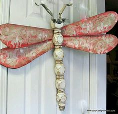 rRecycled table legs & fan blades = dragonfly