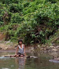 A local peasant girl on a bamboo raft, Pagsanjan river, Luzon, the Philippines.