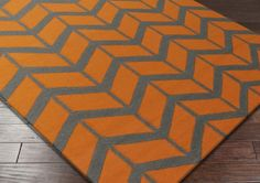 Surya Fallon FAL-1089 Area Rug From delicate lattice patterns to boldly colored chevron patterns the Fallon Collection makes a statement in flat weave; from creator Jill Rosenwald known for her beautifully colored, hand-made ceramics.