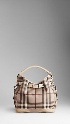 Burberry bag, saved up forever for this baby.. then of course Diesel chewed a hole in the cornor.. screw it, still works ha