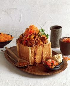 Mutton curry bunny chow with carrot salad and coriander sambal, could there be anything better? Make this local classic from scratch! Curry Ingredients, Salad Ingredients, Salted Caramel Fudge, Salted Caramels, Kos, Lamb Curry, Food Tech, Curry Recipes, Lamb Recipes