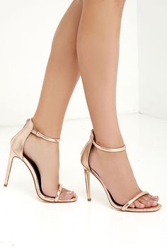 """Put together all your favorite outfits with the Keen Eye Rose Gold Ankle Strap Heels! Metallic rose gold vegan leather shapes a padded toe band and ankle strap. 3"""" back zipper."""