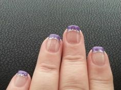 Purple french manicure with silver glitter.