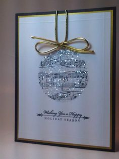 Adding glitter to cut circles of sheet music for your favorite song creates a beautiful Christmas card!