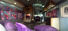 Small school bus remodeled into mobil home complete with fireplace and bathroom.