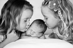 amazing photos here. sweet sweet. big sisters with their new little love