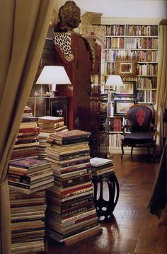 I don't like the atmosphere of this room - too stuffy, too studious - but I want a ton of books in my house like this.