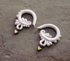 Love Warrior Gauges by TheCreatorsCreations on Etsy, $44.00  Hate the name but they're pretty. Size 0g for me.