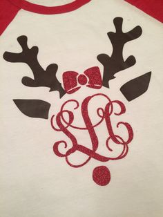 """This long sleeve comfy tee is perfect for the holidays! Raglan style, white with red sleeves, with reindeer ears and your monogram in glittery red vinyl! Precious!! Order a size up to wear with leggings! Shirt details are as follows:  •4.2 oz.,100% combed ringspun cotton, 30 singles •Heather Navy and Heather Brown are 52/48 cotton/polyester •Coverstitched collar •2"""" rib cuffs  This shirt is made with heat applied vinyl brown and glittery red. Best if washed inside out.  Sizes available…"""