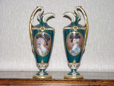 Royal Worcester hand painted Ewers,by F.N.Sutton c1903