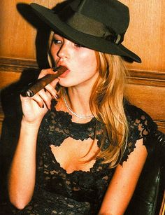 There's just something sexy about a women who smokes Cigars!