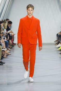 Vibrant tailored look with a orange polo from the #LacosteSS16 fashion show. ©Yannis Vlamos