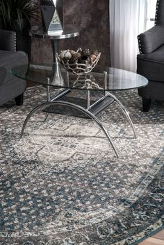 Add a traditional look to your living room with this machine made, 100 percent polypropylene vintage medallion rug. This quality product comes with a comfortable feel to your tired feet and is available in rectangle, round and runner shapes.