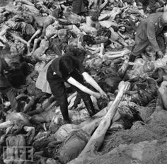 Former camp guard Anneliese Kohlmann is forced to bury the victims at the liberated Bergen-Belsen concentration camp in Lower Saxony, during World War II, May 1945.