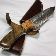 Blade Steel: Damascus - 256 layers of 1095 and 15N20 Blade Hardness: 58-60 HRC Blade Length: 4.25 inches Grind: hollow, double bevel Handle Material: Figured English Walnut, Cherry Burl and Solid Stainless Steel pins Handle Length: 4.25 inches Handle Finish: Thin and Medium CA, Tripoli and White Diamond buffing compounds, and Carnauba wax  Sheath: Custom Amish-made from top grain, medium brown Bridle Leather