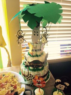 Fun diaper cake at a jungle baby shower party! See more party planning ideas at CatchMyParty.com!