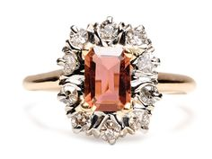 1920s tourmaline and diamond rind. Rectangular cut pink tourmaline, about 1 carat with a 9 old single cut diamond surround, total weight of .22 carats, mounted in 14k white and rose gold. Circa 1920