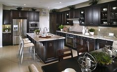 Kitchen features stainless steel appliances, granite countertops and culinary prep island. - Residence 1 at Camino at La Floresta in Brea, CA