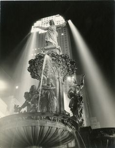 """The """"Genius of Water"""" is without a doubt one of Cincinnati's greatest treasures and Paul Briol captured it beautifully illuminated against the backdrop of Carew Tower in the 1940s. #VintageCincinnati #CincinnatiHistory"""