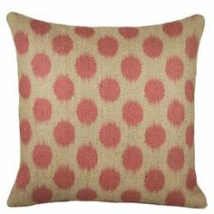 "Bring a pop of pattern to your sofa or favorite arm chair with this rustic-chic burlap pillow, showcasing a polka-dot motif in pink.   Product: PillowConstruction Material: BurlapColor: Pink and beigeFeatures: Insert includedDimensions: 16"" x 16"""