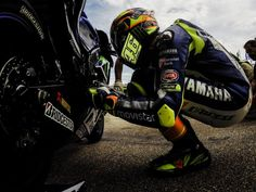 A #ritual performed by Valentino Rossi everytime before he jumps on his bike. Helps get the mind frame in pace. #masterclass http://www.motogp.com/en/gallery/2015/07/12/best-shots-of-german-gp/179758