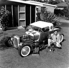 Barons of Westchester (California) member John Rasmussen with Buzz Pitzen's 1929 Ford Model A Roadster. Photo by Eric Rickman, 1958.