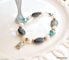 Dark green stone, freshwater pearl, and emerald Swarovski crystal bracelet with turtle charm.