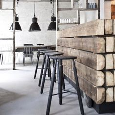 The wooden bar table is great even when it's surrounded by black and white. It doesn't have to be too 'industrial', a little bit shiny finishing might come in handy.