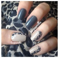 Short gray nails with leopard accent nail.