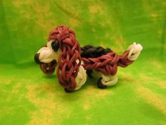How to make a Basset Hound Dog or Puppy on the Rainbow Loom by Lovely Lovebird Designs. Copyright 2014. Please Subscribe! I will be making more dog charms. : )