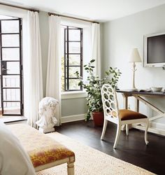 Tranquil.  Design by Nate Berkus for Billy Joel NYC townhouse.  Love the black, metal windows.  Simple white curtain panels hung at ceiling by simple rods.  Why did I purge all my old Domino mags?!  These images are hard to find!