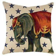 """Bring a pop of whimsical style to your sofa or favorite reading nook with this charming burlap pillow, featuring a circus elephant detail against a blue star background. Handmade in the USA.   Product: PillowConstruction Material: Burlap coverColor: Blue, red and beigeFeatures: Insert included Handmade by TheWatsonShopZipper enclosureMade in the USA Dimensions: 16"""" x 16""""Cleaning and Care: Spot clean"""