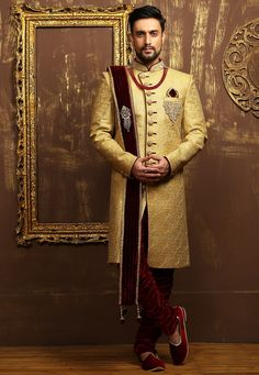 Art Silk Brocade  Sherwani with Satin lining in Beige This Readymade attire is designed with Zardosi, Stone, Zari, Resham, Sequin, Buttons and Patch Border Work Available with a Velvet Breches in Maroon Do note: Dupatta and Accessories shown in the image is for presentation purposes only. Half to one inch may vary in measurement. (slight variation in actual color vs. image is possible)