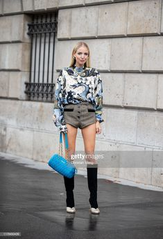 Leonie Hanne seen wearing blouse with graphic print, brown shorts, blue Miu Miu bag, black two tone boots outside Miu Miu during Paris Fashion Week Womenswear Spring Summer 2020 on October Get premium, high resolution news photos at Getty Images Two Tone Boots, Leonie Hanne, Brown Shorts, Graphic Prints, Paris Fashion, Women Wear, Spring Summer, Street Style, News