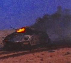 Bradley IFV burns after being hit by Iraqi T-72 fire.