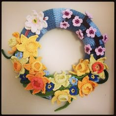 A Spring crochet wreath made in Rowan Hand Knit Cotton. Happy birthday to our lovely baby boy Freddie, who should be 5 today. With daffodils, for-get-me-nots and cherry blossom.