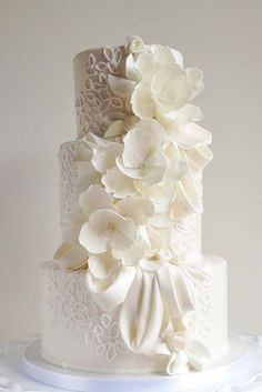 Simple, Elegant, Chic Wedding Cakes ❤ See more: http://www.weddingforward.com/simple-elegant-chic-wedding-cakes/ #weddings