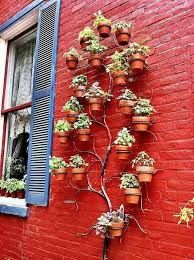 Pretty cool idea : tree wall planter great idea for an herb garden possibly. could easily be done with hangapot hangers Dream Garden, Home And Garden, Big Garden, Garden Fun, Deco Floral, Tree Shapes, Vertical Gardens, Vertical Planter, My Secret Garden
