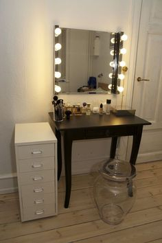 Made from IKEA lights and mirror. I must make this for my beauty room!!