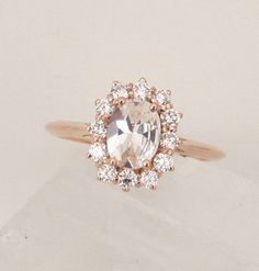 Ali's note - adore the shape & the rose gold. Also that sapphires are cheaper than diamonds I'm pretty sure...   White Sapphire Engagement Ring Rose Gold by PristineJewelry