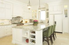 Transitional kitchen with a punch of green via www.cmidesign.ca