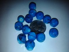 14 Glass Turquoise Beads by EphemerasLanding on Etsy, $8.00