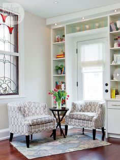 A space for family reading  To bring new life to the landing, striped seafoam wallpaper plays on the blues introduced downstairs. New built-ins for books, as well as a pair of cozy chairs, have transformed the space into a destination for family reading.